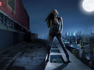 The girl on the roof of the full moon